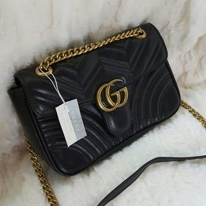 Chained quilted handbag